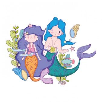 Unterseeische szene der paarmeerjungfrauen