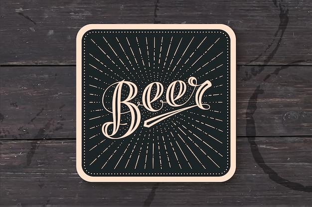 Untersetzer mit handgezeichneten schriftzug bier