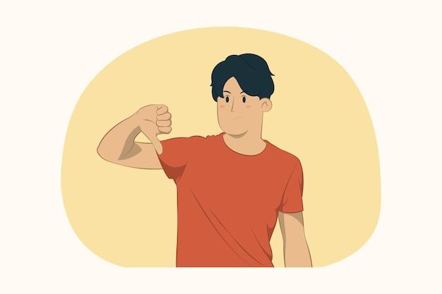 Unzufriedener junger mann, der daumen nach unten konzept zeigt