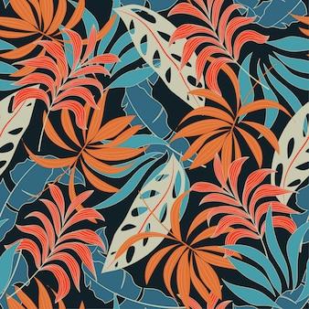 Ursprüngliches nahtloses tropisches muster mit hellen roten und blauen anlagen und blättern