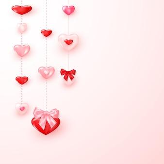 Valentinskarte verzierte glänzende rote und rosa herzen. valentinstag grußkartenvorlage.
