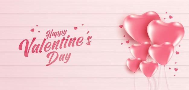 Valentinstag-banner mit vielen süßen herzen auf weichem rosa farbholzhintergrund.