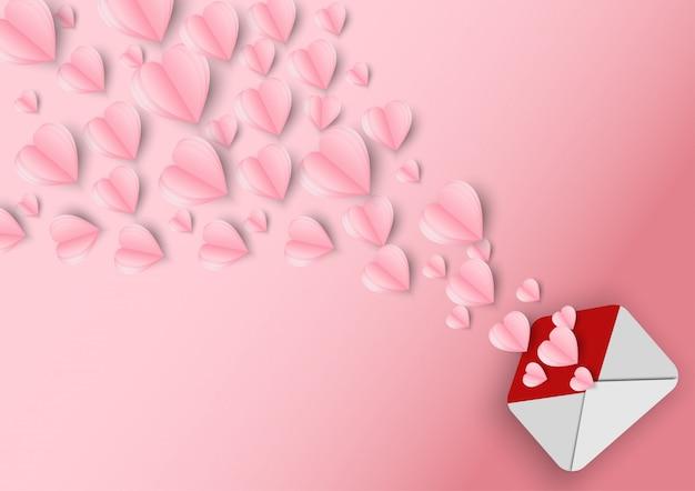 Valentinstag herzen und brief. origami machte das papierherz, das heraus weg vom buchstaben fliegt.