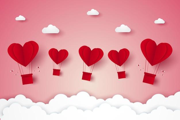 Valentinstag illustration der heißluftballons des roten herzens der liebe, die in den himmelpapierkunststil fliegen