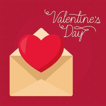 Valentinstag schriftzug und ein umschlag mit einem herzen heraus