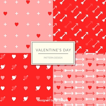 Valentinstagherzen und pfeilmustersammlung