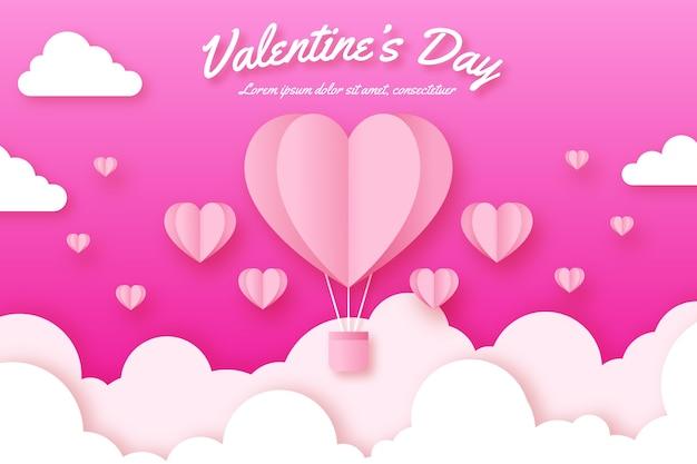 Valentinstaghintergrund mit heißem herzen steigt im himmel im ballon auf