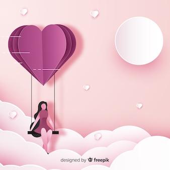 Valentinstagmädchen auf schwingenhintergrund