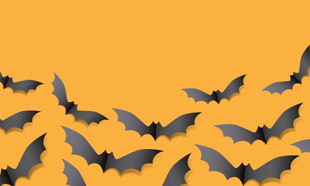 Vampir fledermaus silhouette papier handwerk. halloween fliegende fledermausdekoration auf orange hintergrund