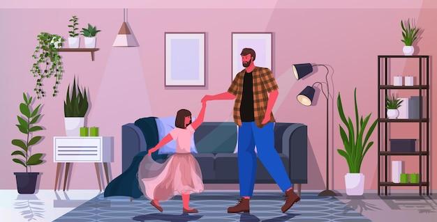 Vater tanzt mit tochter ballett lektion elternschaft vaterschaftskonzept vater verbringt zeit mit seinem kind zu hause horizontal in voller länge