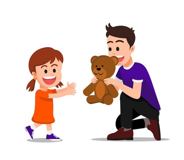 Vater überrascht seine tochter mit einem teddybären als geschenk