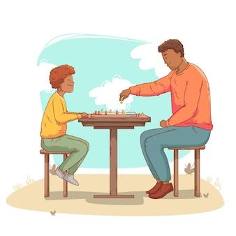 Vater und sohn spielen zusammen ein ludo-spiel