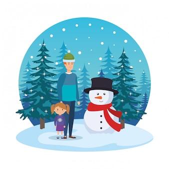 Vater und tochter mit weihnachtskleidung in der schneelandschaft