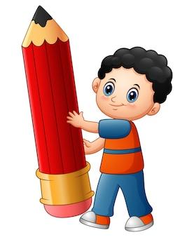 Vector illustration der karikatur des kleinen jungen, die einen bleistift hält