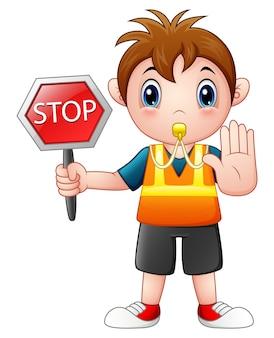 Vector illustration des karikaturjungen, der ein stoppschild hält