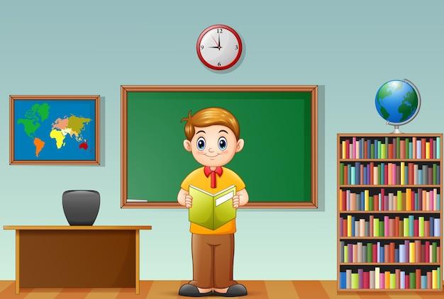 Vector illustration des schuljungen ein buch im klassenzimmer lesend