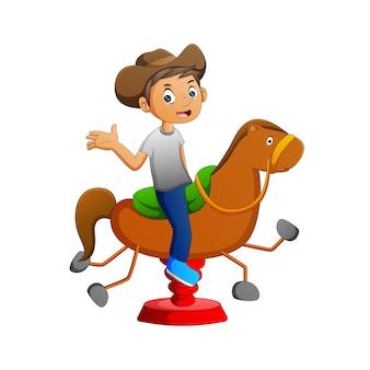 Vector illustration eines cowboys, der ein spielzeugpferd spielt