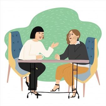 Vector karikaturillustration von zwei freundinnen, die in einem trinkenden kaffee und in einer unterhaltung des cafés sitzen. leben, gespräch, freundschaftskonzept, gezeichnete illustration des vektors hand.