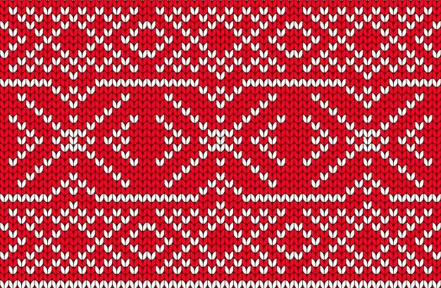 Vector nahtloses nordisches strickendes muster in den roten und weißen farben. weihnachts- und winterurlaub sweater design. fair isle mit purl-stitch-methode. einfach stricken.