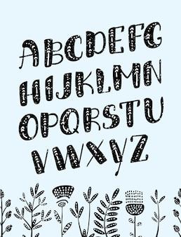 Vektor-cartoon boho bunt etwas alphabet. ethnische buchstaben und pfeile des vektors. niedliche und lustige abc-großbuchstaben auf dunklem hintergrund, verziert mit blumen für ihr design.