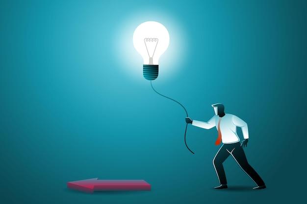 Vektor-illustration des geschäftskonzepts, geschäftsmann, der eine glühbirne hält, um die richtung des pfeils zu zeigen
