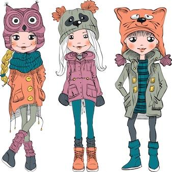 Vektor set süße mädchen in lustigen hüten vektor set mode mädchen in winterkleidung