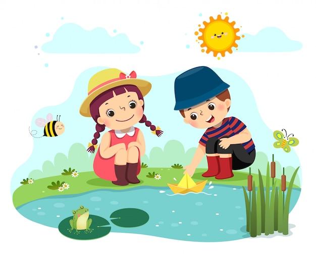 Vektorillustrationskarikatur von zwei kleinen kindern, die mit papierboot im teich spielen.