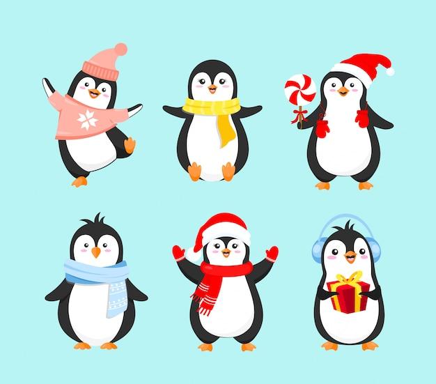 Vektorillustrationssatz der niedlichen pinguine in der winterkleidung. frohe weihnachten konzept, frohes neues jahr und winterferien. pinguinsammlung auf hellblauem hintergrund im flachen karikaturstil.