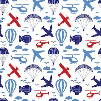Vektornahtloses muster mit flugzeugen, hubschrauber, fallschirm, ballon, luftschiff in den wolken