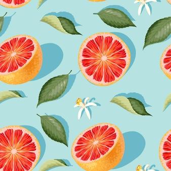 Vektornahtloses muster mit grapefruitscheiben und blättern auf blauem hintergrund
