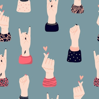 Vektornahtloses muster mit mädchenhänden und verschiedenen gesten. konzept von mädchenpower und feminismus. internationaler frauentag, mädchenprotest