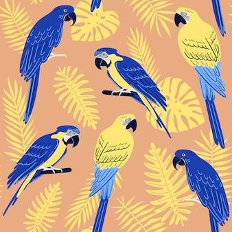 Vektornahtloses muster mit tropischen monstera-blättern, palmen, farnen und papageien: blau- und goldara und hyazinth-ara. sommerabbildung
