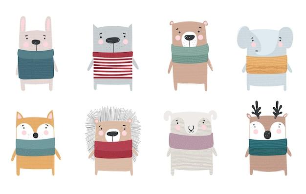 Vektorsammlung von strichzeichnungen von niedlichen wintertieren in gemütlicher kleidung doodle illustration