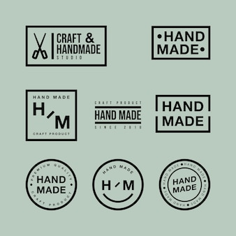 Vektorsatz von linearen abzeichen und logo-designelementen für handgemachtes in flachem design auf grünem hintergrund
