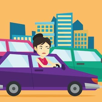 Verärgerte asiatische frau im auto im stau stecken.