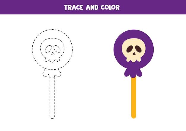 Verfolgen und färben sie halloween-lutscher. arbeitsblatt für kinder.