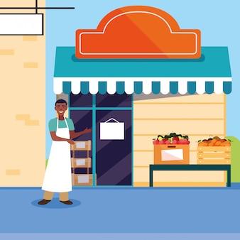 Verkäufer mit fruchtspeicher-fassadengebäude