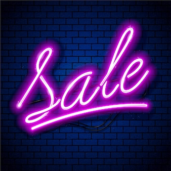 Verkauf rosa neon-schriftzug-vektorgrafiken auf tiefblauem backsteinmauerhintergrund.