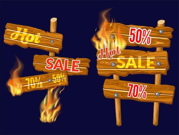 Verkaufstafeln aus holz mit flammenbrand.