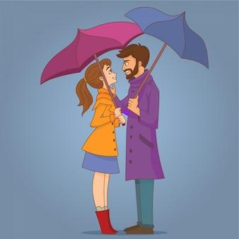 Verliebte paare unter regenschirm