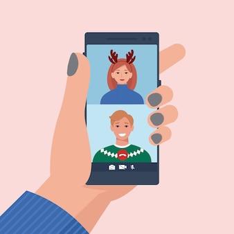 Verliebtes paar in weihnachtskleidung, das auf einem videoanruf spricht. im flachen stil