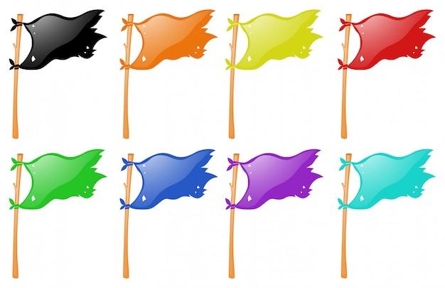 Verschiedene farbflaggen auf holzstab