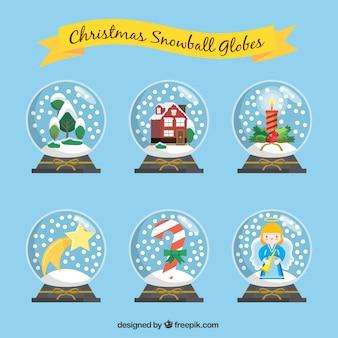 Verschiedene schneekugeln mit schönen weihnachten elemente