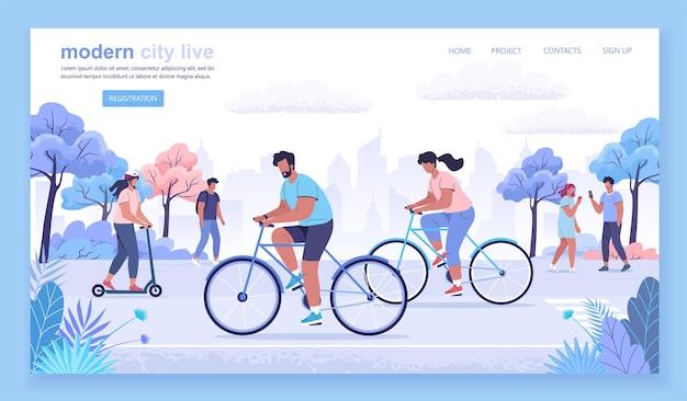 Verschiedene sportliche junge leute, die im modernen stadtpark fahrrad fahren und fahren