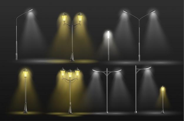 Verschiedene stadtstraßenlaternen, die in warmes und kaltes weißes licht der dunkelheit gelb glühen