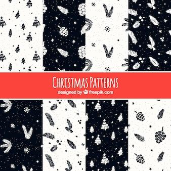 Verschiedene weihnachtsmuster mit skizzen von natürlichen elementen