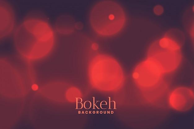 Verschwommener hintergrund mit bokeh-lichteffekt in verblasstem rot
