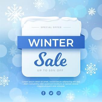 Verschwommener winterschlussverkauf mit schneeflocken