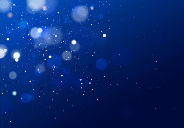 Verschwommenes bokeh-licht auf dunkelblauem hintergrund. und neujahrsfeiertage vorlage. abstraktes glitzern defokussierte blinkende sterne und funken.