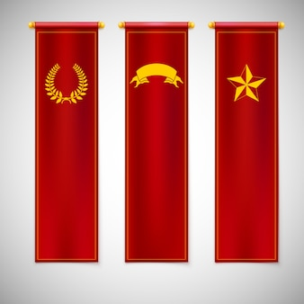 Vertikale rote fahnen mit emblemen.